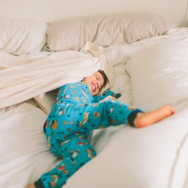 Toddler in a Queen Size Bed