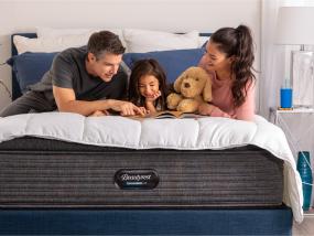 family sitting on Simmons Beautyrest innerspring mattress